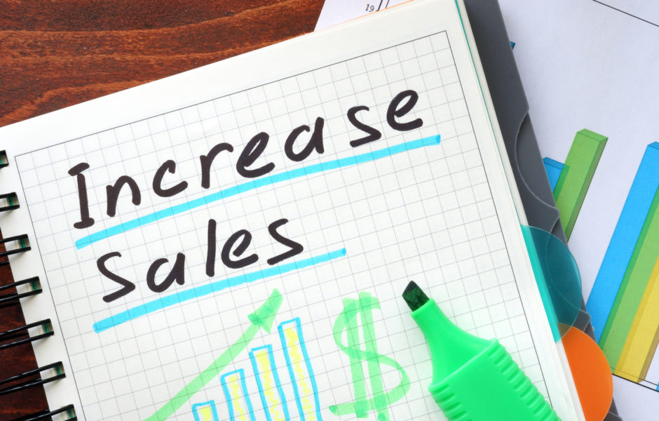 Increase sales concept  written in a notebook.
